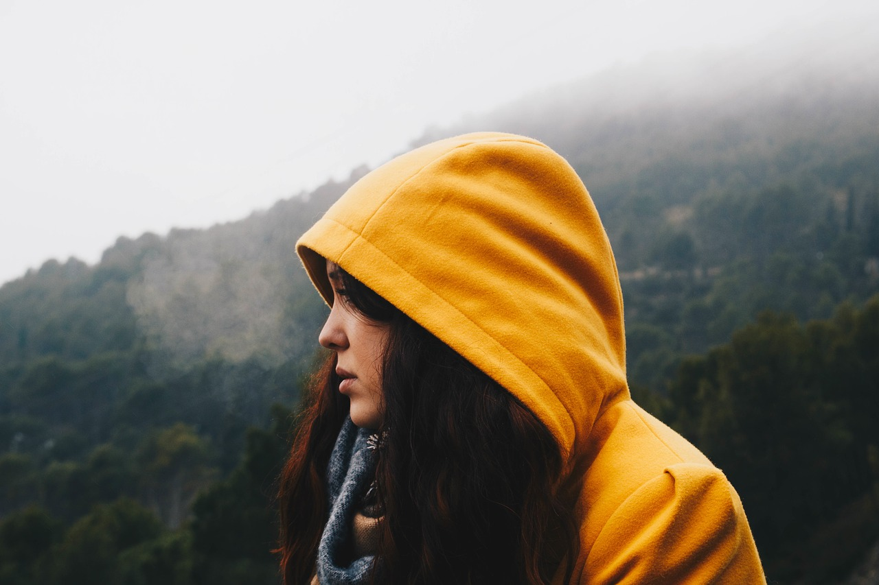 How to file taxes if divorced during year. Young woman with hoodie. #taxtips #divorce