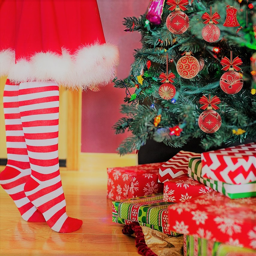 Saving and budget for the holidays. Christmas stockings by tree.