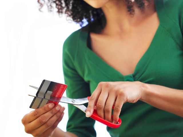 Dave Ramsey Plan Baby Steps List Lady cutting up credit card
