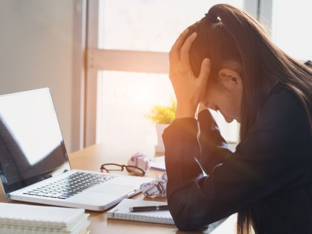 Woman worried about Tax Identity Theft at her desk
