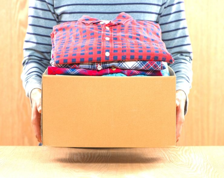 Box of clothes to sell to help save money fast