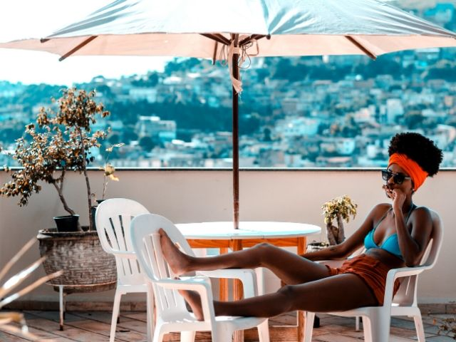 Tax Season Preparing know when to check refund chart. A top tax tip with black lady relaxing on vacation.
