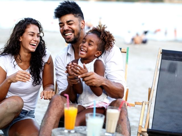 Tax Season Preparing know your filing status. A top tax tip with happy family on the beach.