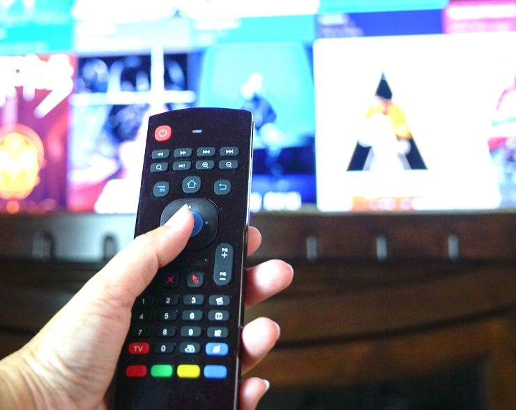 Woman getting rid of online streaming services to help save money fast.