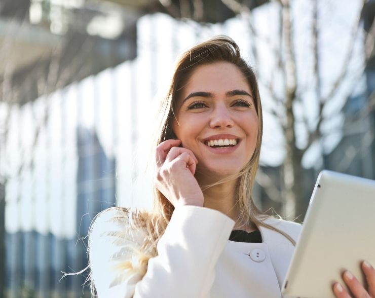 Woman happy about submitting IRS form 9465 for repayment plan on the phone