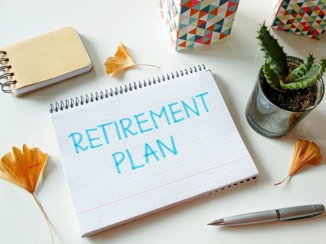 Retirement plan written on white notebook