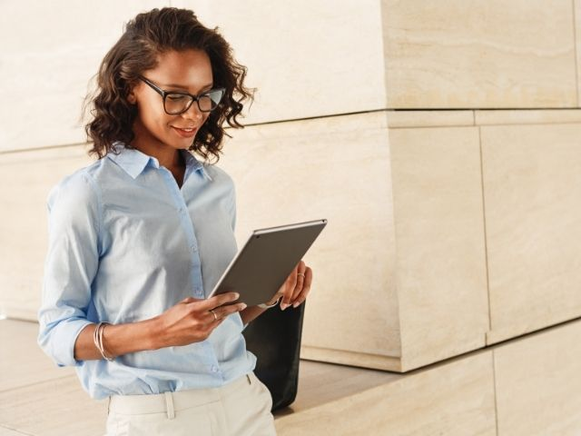 Tax Updates with black woman on ipad
