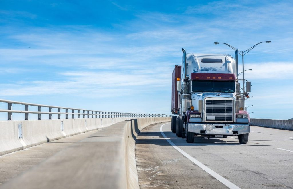 IRS Form 2290 trucker driving on scenic highway