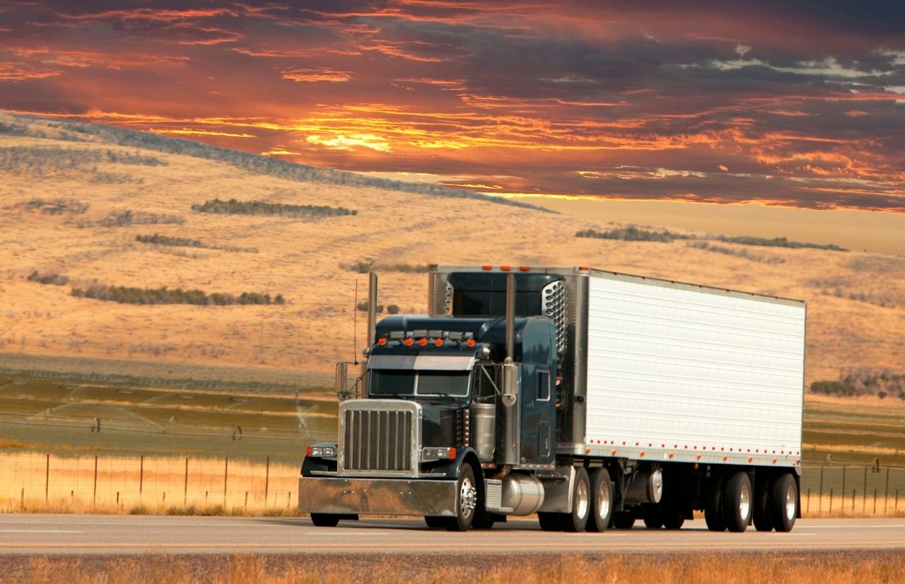 IRS Form 2290 trucker on scenic farmland