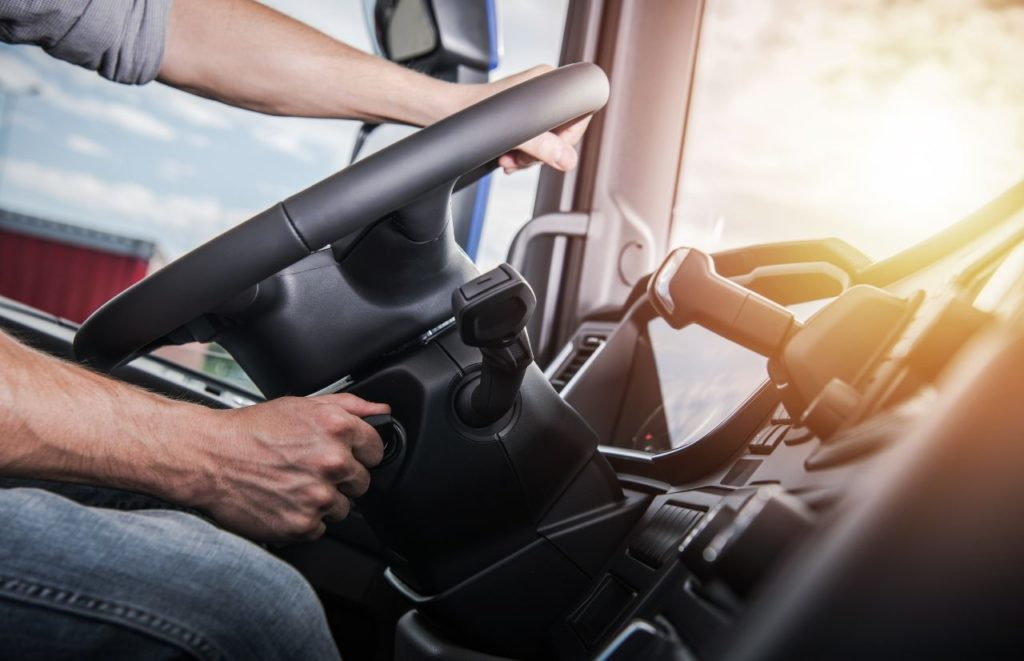 IRS Form 2290 white male trucker driving