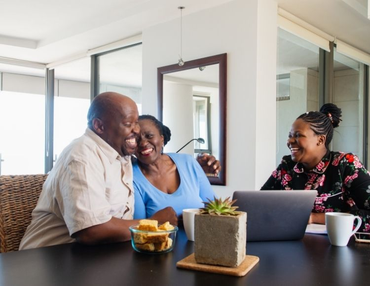 Black couple viewing computer while estate planning for inheritance tax in Florida.