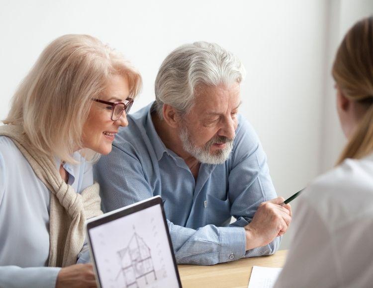 Elderly white couple doing estate planning