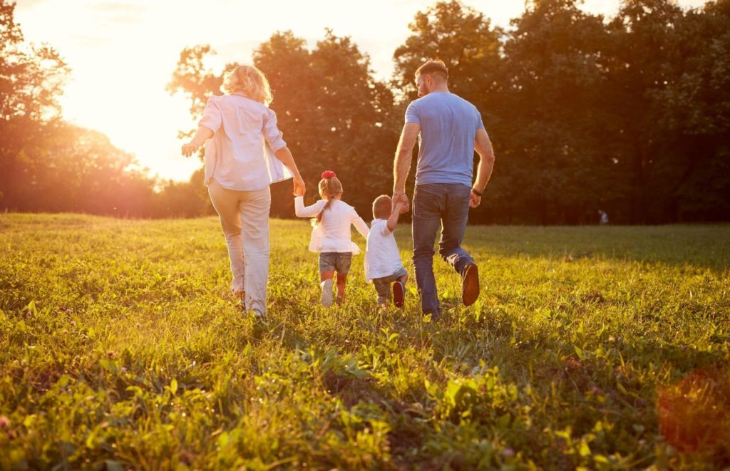 Child Tax Credit with young family running in the field