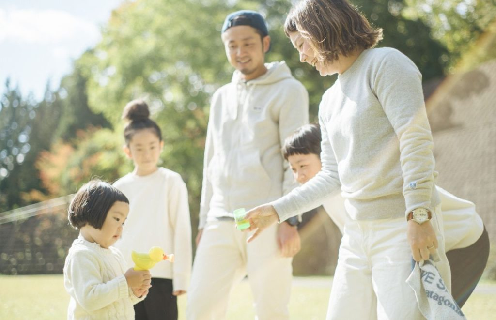 Child Tax Credit young Asian family blowing bubbles