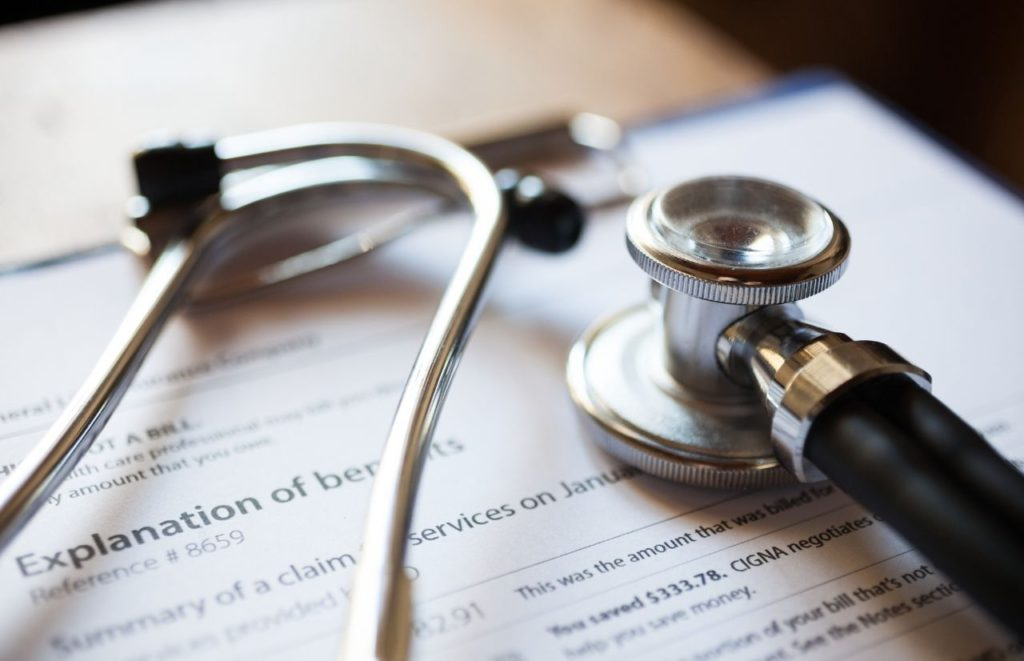 Health insurance benefits explained with stethoscope Is Lasik Surgery Tax Deductible?