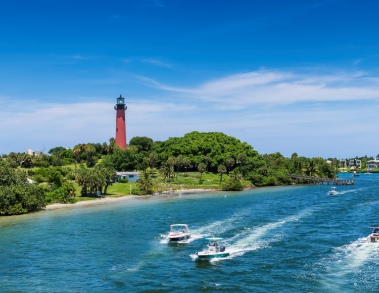 Jupiter Beach Florida with boats in water. Top question is there an inheritance tax in Florida?